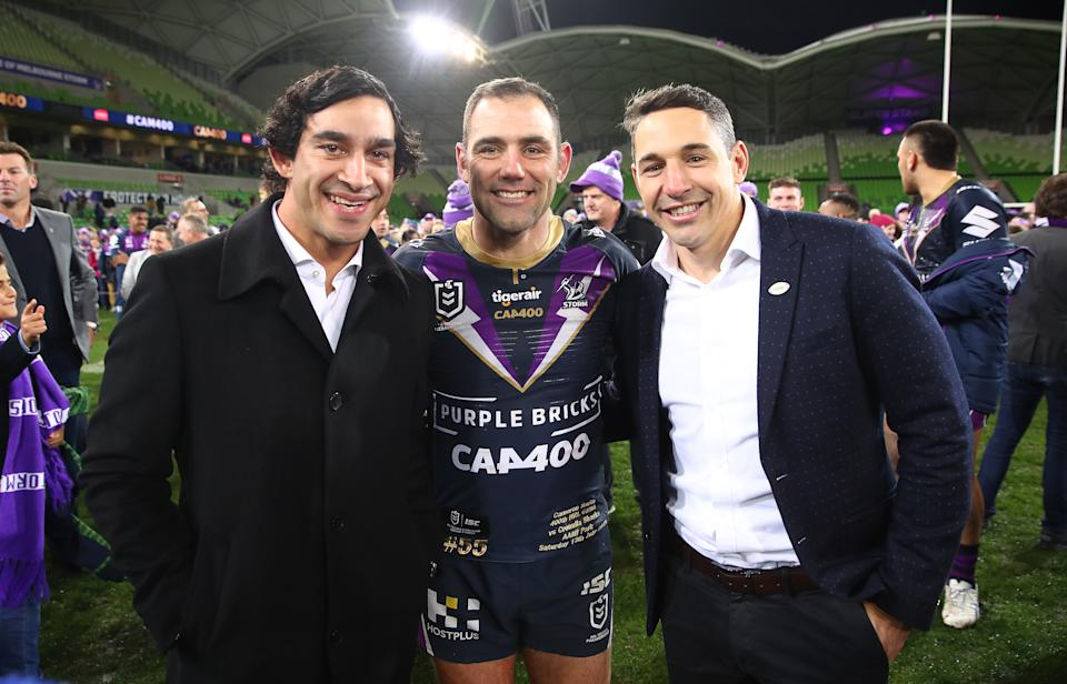 Melbourne Storm Captain Cameron Smith poses with Johnathan Thurston and Billy Slater as he leaves the field after becoming the first player to reach 400 matches during the round 17 NRL match.