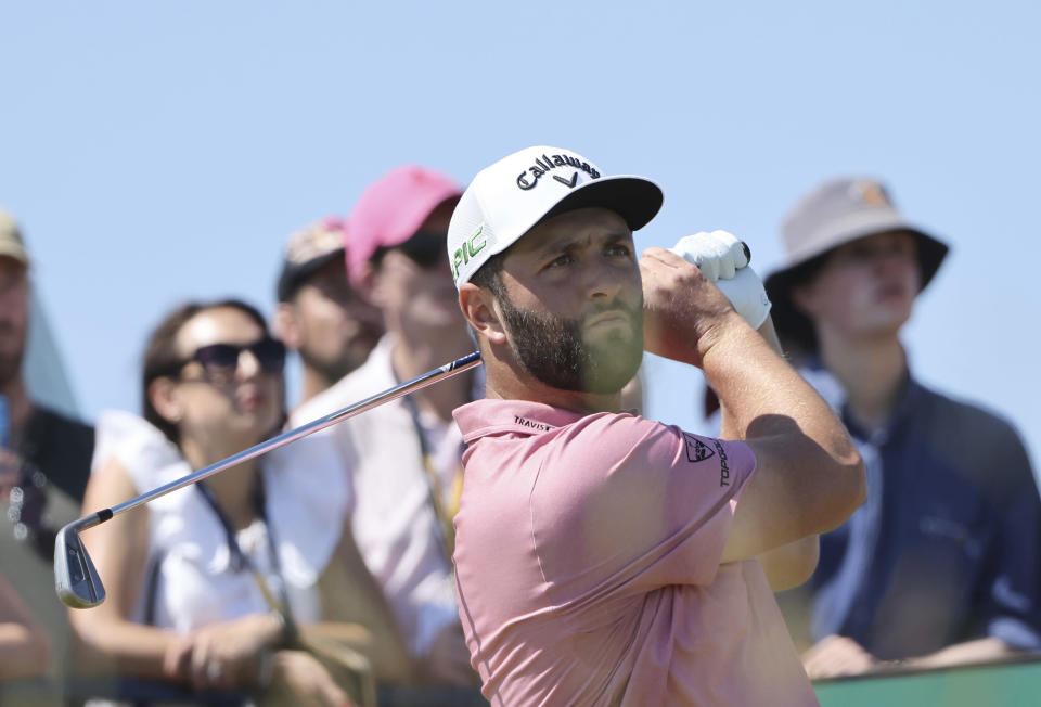 Spain's Jon Rahm plays his tee shot on the 3rd tee during the final round of the British Open Golf Championship at Royal St George's golf course Sandwich, England, Sunday, July 18, 2021. (AP Photo/Ian Walton)