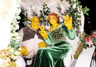 <p>The supermodel outdid herself this year at her annual Halloween bash, dressing up in green-coloured prosthetics to become Fiona from Shrek. Boyfriend Tom Kaulitz helpfully stepped in as Shrek. <i>[Photo: Getty]</i> </p>