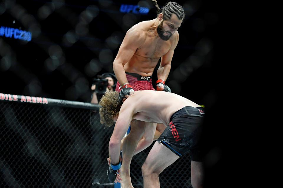 Jul 6, 2019; Las Vegas, NV, USA; Jorge Masvidal (red gloves) fights against Ben Askren (blue gloves) at T-Mobile Arena. Jorge Masvidal set a new record for the fastest knockout in UFC history with five seconds. Mandatory Credit: Stephen R. Sylvanie-USA TODAY Sports