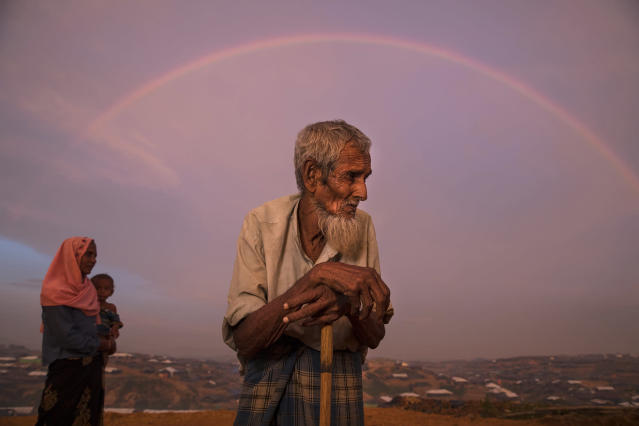 <p>Abu Siddique, 90, stands on a hill overlooking the Kutupalong refugee camp, as a rainbow covers the sky on September 22, 2017. He spent all of his savings to pay people to carry him across the Myanmar border to Bangladesh. (Photograph by Paula Bronstein/UNHCR) </p>