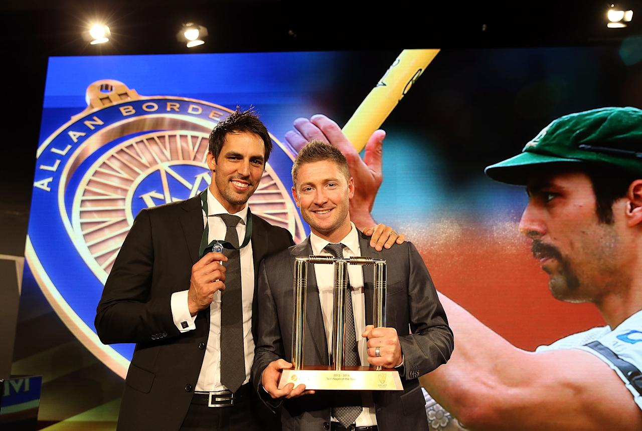 SYDNEY, AUSTRALIA - JANUARY 20:  Mitchell Johnson poses with Michael Clarke after winning the Allan Border Medal during the 2014 Allan Border Medal at Doltone House on January 20, 2014 in Sydney, Australia.  (Photo by Mark Metcalfe/Getty Images)