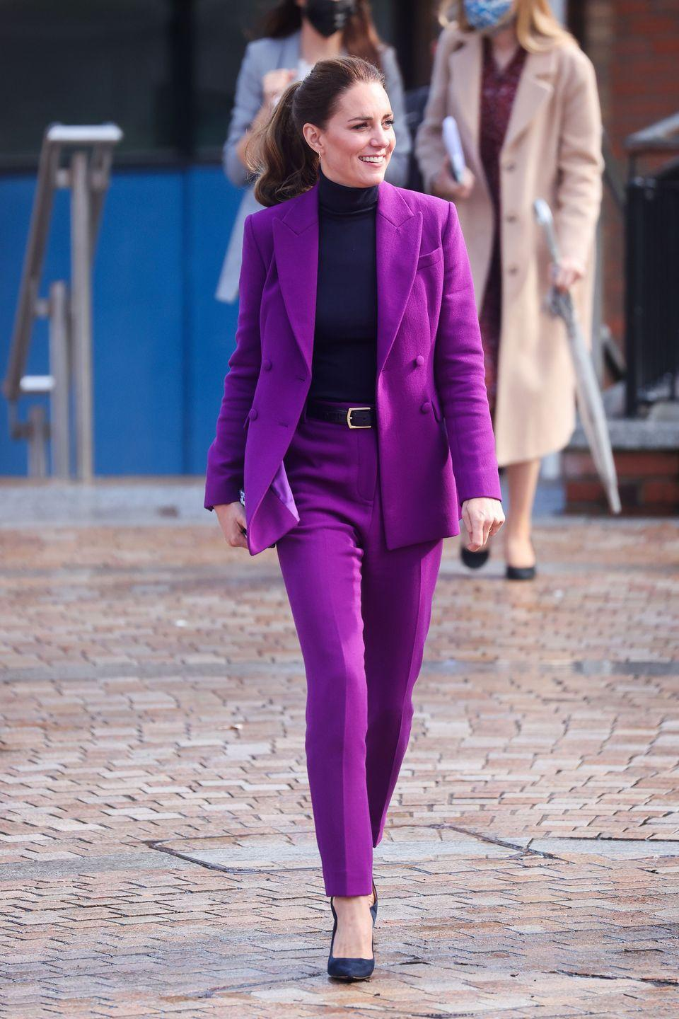 <p><strong>September 2021</strong> The Duchess of Cambridge stepped out of her style comfort zone in a regal violet suit by Emilia Wickstead for a tour of a university campus in Derry, Northern Ireland. The paired the purple two-piece with suede courts and a black polo neck jumper.</p>
