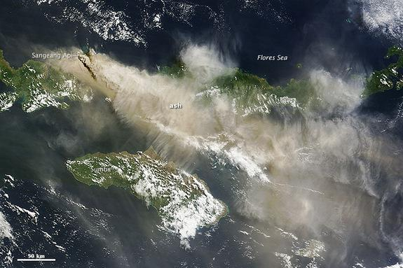 Ash from the Sangeang Api volcano in Indonesia drifts southeast in this NASA satellite image, captured May 31, 2014.