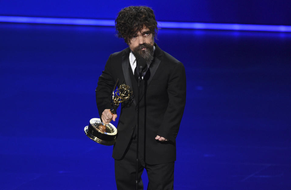 "Peter Dinklage accepts the award for outstanding supporting actor in a drama series for ""Game of Thrones"" at the 71st Primetime Emmy Awards on Sunday, Sept. 22, 2019, at the Microsoft Theater in Los Angeles. (Photo by Chris Pizzello/Invision/AP)"