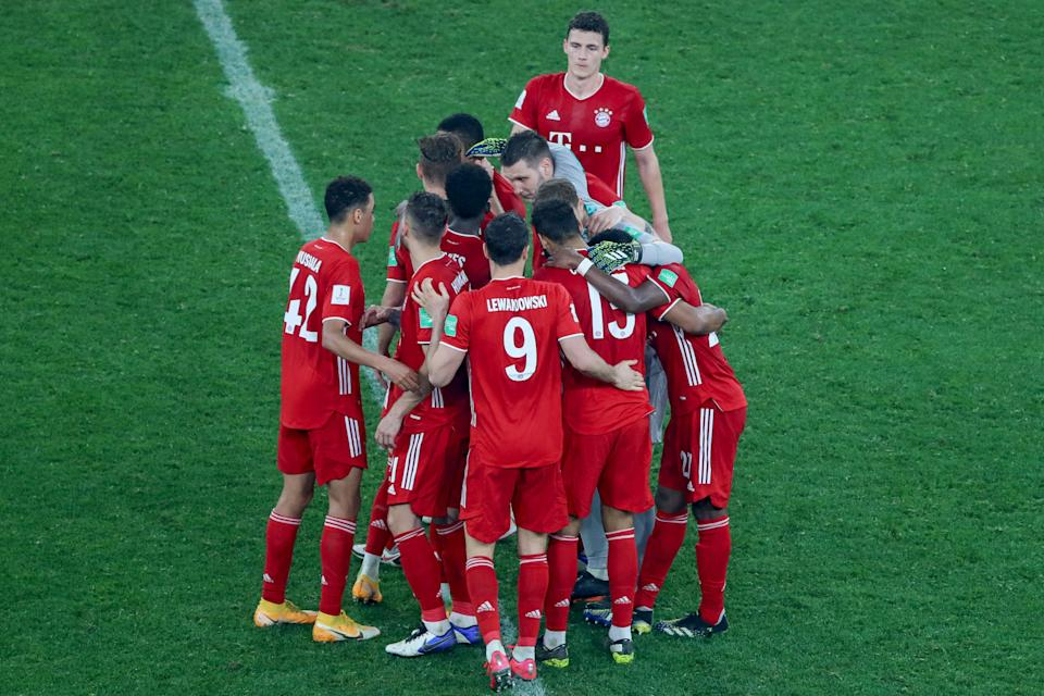 Bayern's players celebrate their win in the FIFA Club World Cup final football match between Germany's Bayern Munich vs Mexico's UANL Tigres at the Education City Stadium in the Qatari city of Ar-Rayyan on February 11, 2021. (Photo by Karim JAAFAR / AFP) (Photo by KARIM JAAFAR/AFP via Getty Images)