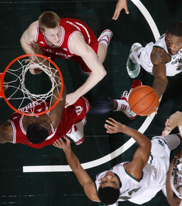 Michigan State's Branden Dawson, top right, grabs a rebound against Indiana's Jeff Howard, top left, and Noah Vonleh, bottom left, and Michigan State Gary Harris, bottom right, during the second half of an NCAA college basketball game, Tuesday, Jan. 21, 2014, in East Lansing, Mich. Michigan State won 71-66. (AP Photo/Al Goldis)