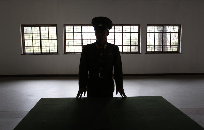"A North Korean military officer talks the history at a museum hall at Demilitarized Zone that separates the two Koreas in Panmunjom, North Korea Monday, April 23, 2012. North Korea promised Monday to reduce South Korea's conservative government ""to ashes"" in less than four minutes, in an unusually specific escalation of recent threats aimed at its southern rival.  The statement by North Korea's military, carried by state media, comes amid rising tensions on the Korean peninsula. Both Koreas recently unveiled new missiles, and the North unsuccessfully launched a long-range rocket earlier this month.  (AP Photo/Vincent Yu)"