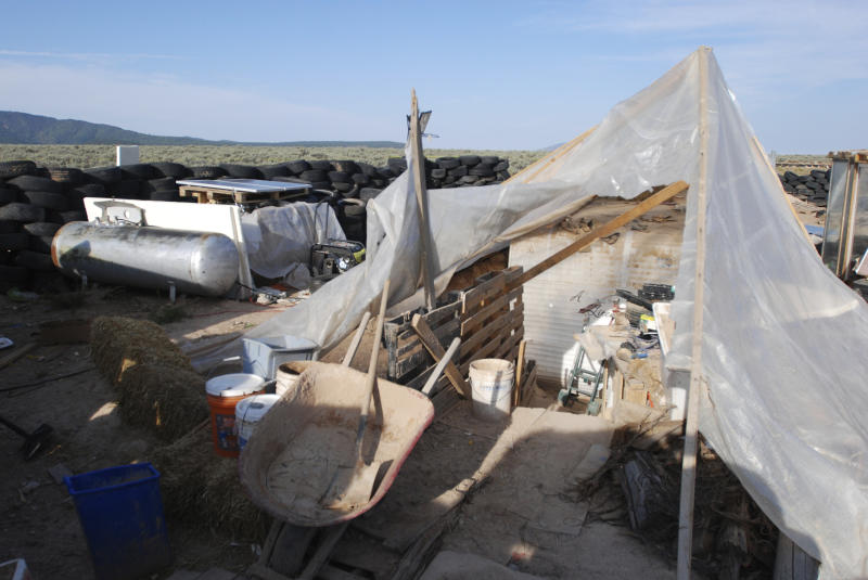 Various items litter a squalid makeshift living compound in Amalia N.M. on Friday Aug. 10 2018 where five adults were arrested on child abuse charges and remains of a boy were found. The remains which haven't been positively identified may res