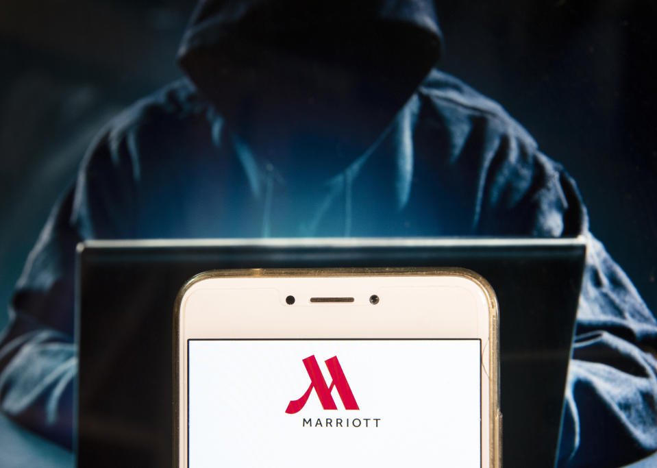 HONG KONG - 2018/12/02:  In this photo illustration, the American multinational diversified hospitality company Marriott International logo is seen displayed on an Android mobile device with a figure of hacker in the background. (Photo Illustration by Miguel Candela/SOPA Images/LightRocket via Getty Images)