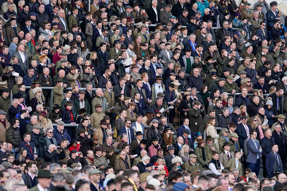 A general view as racegoers watch the action on Gold Cup day at Cheltenham Racecourse on March 13, 2020 in Cheltenham, England.