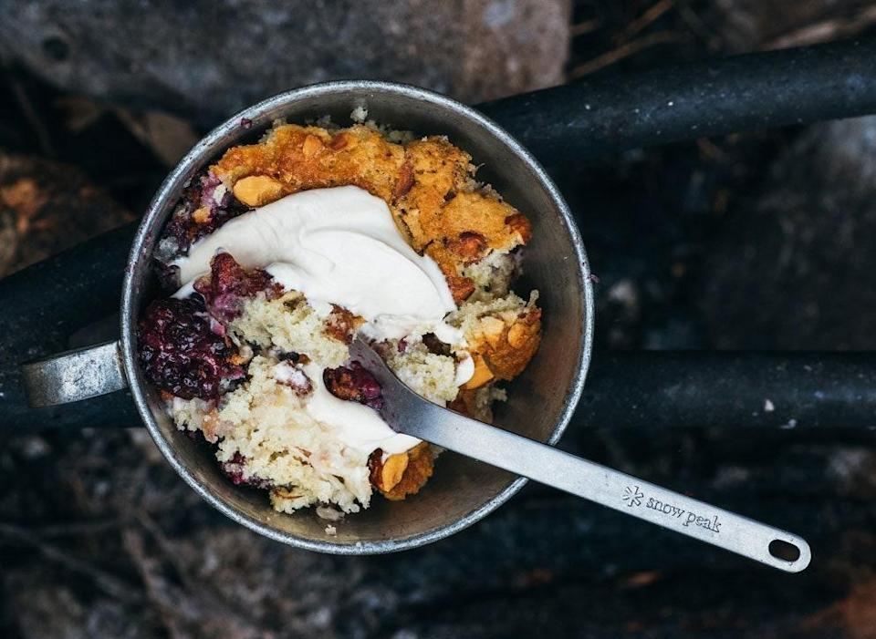 """Line your Dutch oven with heavy-duty foil before baking for an effortless cleanup. <a href=""""https://www.bonappetit.com/recipe/peach-blackberry-camp-cake?mbid=synd_yahoo_rss"""" rel=""""nofollow noopener"""" target=""""_blank"""" data-ylk=""""slk:See recipe."""" class=""""link rapid-noclick-resp"""">See recipe.</a>"""