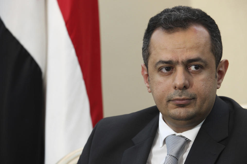 "FILE - In this Wednesday, Dec. 12, 2018 file photo, Maeen Abdulmalik Saeed, the prime minister of Yemen's internationally recognized government that the Saudi-led coalition backs, is interviewed by foreign journalists in Aden, Yemen. Yemen's prime minister Maeen Abdulmalik Saeed on Saturday Jan. 2, 2021, said that an attack on the airport in the key port city of Aden was meant ""to eliminate"" the country's new government. The Prime Minister spoke to The Associated Press after he survived Wednesday's attack that killed at least 25 people and wounded 110 others. (AP Photo/Jon Gambrell, File)"