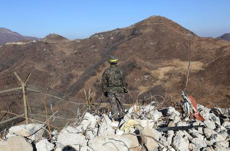 A South Korean army soldier stands guard at the South's dismantled guard post inside the Demilitarized Zone (DMZ) in the central section of the inter-Korean border in Cheorwon, December 12, 2018. Ahn Young-joon/Pool via REUTERS