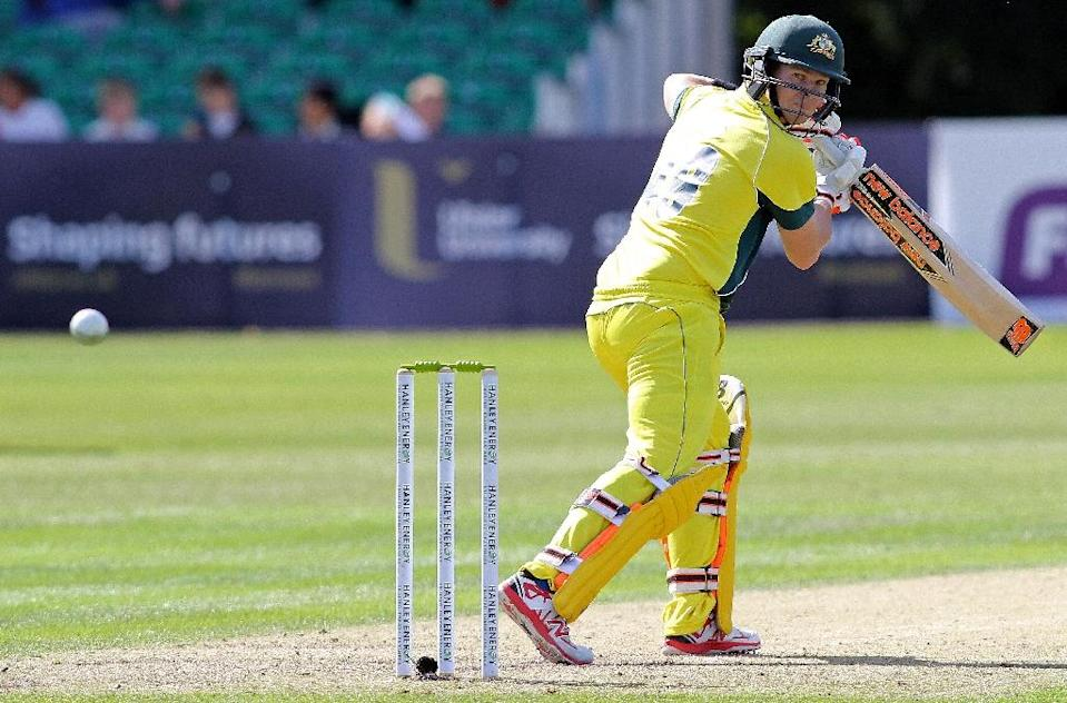 Australia's captain Steve Smith watches the ball before losing his wicket to Ireland's Niall O'Brien during their ODI match at Stormont Cricket Club in Belfast, on August 27, 2015 (AFP Photo/Paul Faith)