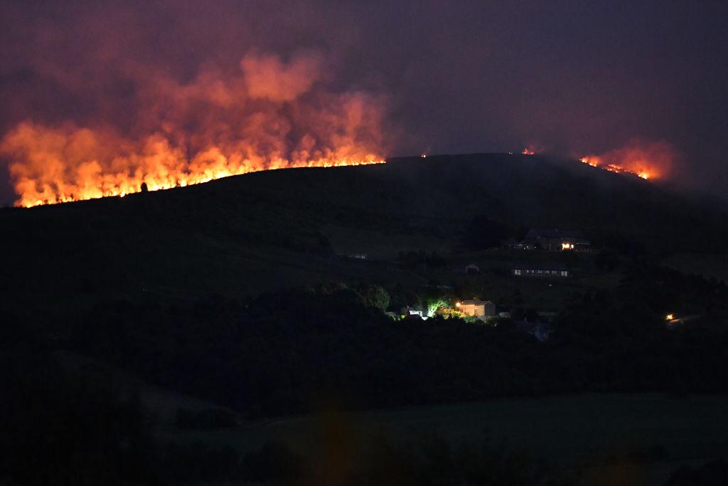 A large wildfire sweeps across the moors between Dovestones and Buckton Vale in Stalybridge (Picture: Getty)