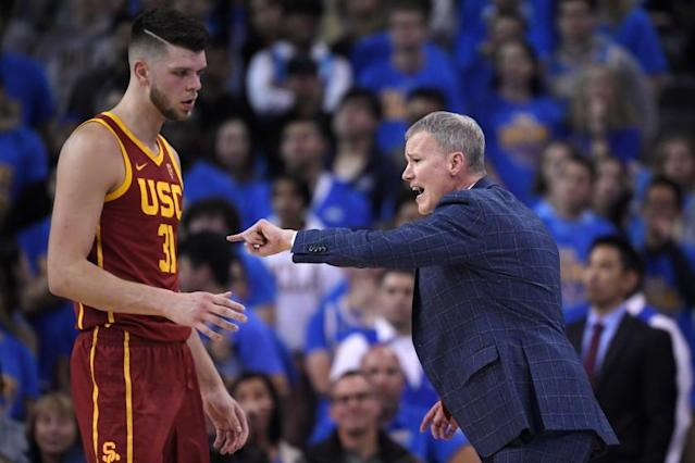 """USC head coach Andy Enfield, right, yells at forward Nick Rakocevic during the first half against UCLA on Jan. 11 at Pauley Pavilion. <span class=""""copyright"""">(Mark J. Terrill / Associated Press)</span>"""