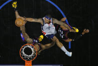 Washington Wizards' Bradley Beal, center, goes up for a shot against Philadelphia 76ers' Dwight Howard, left, and Matisse Thybulle during the second half of Game 2 in a first-round NBA basketball playoff series, Wednesday, May 26, 2021, in Philadelphia. (AP Photo/Matt Slocum)