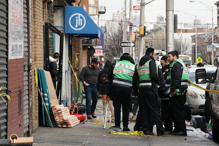 A demolition and recovery crew works at the scene of Tuesday's deadly shooting at a Jewish market in Jersey City, New Jersey. (Photo: BRYAN R. SMITH via Getty Images)