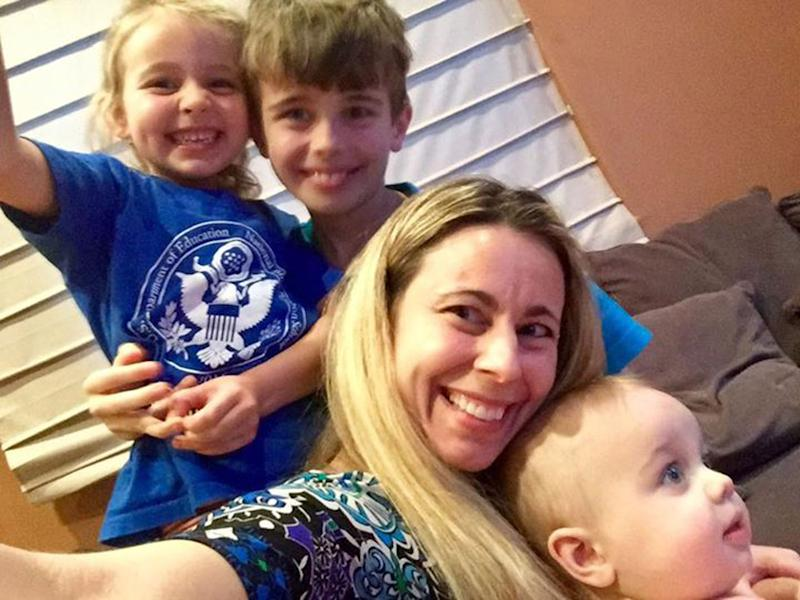 Kristie Homes, 44, pictured with her three kids.