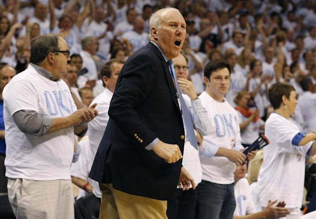 San Antonio Spurs coach Gregg Popovich follows action against the Oklahoma City Thunder in the second half of Game 6 of the Western Conference finals NBA basketball playoff series in Oklahoma City, Saturday, May 31, 2014. (AP Photo/Sue Ogrocki)