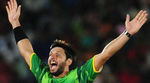 Pakistan cricketer Shahid Afridi celebrates after he dismissed Sri Lankan cricketer Chamara Kapugedera