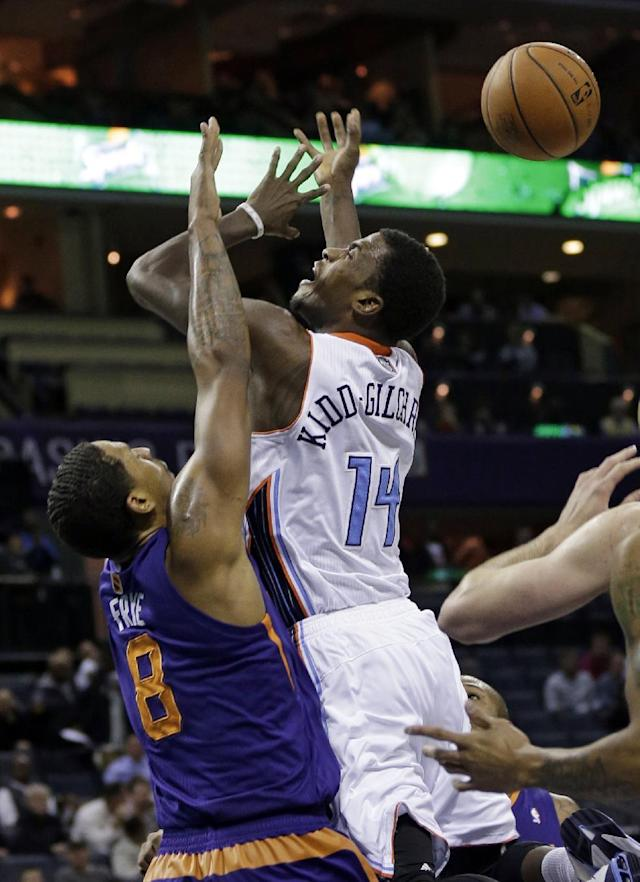 Charlotte Bobcats' Michael Kidd-Gilchrist (14) is fouled by Phoenix Suns' Channing Frye (8) during the first half of an NBA basketball game in Charlotte, N.C., Friday, Nov. 22, 2013. (AP Photo/Chuck Burton)