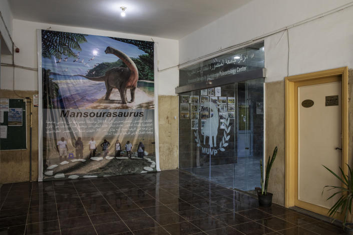 """HOLD The entrance of The Mansoura University Vertebrate Paleontology Center, where the discovery of fossils of a 43 million-year-old four-legged prehistoric whale known as the """"Phiomicetus Anubis,"""" in an evolution of whales from land to sea, which was unearthed over a decade ago in Fayoum in the Western Desert of Egypt, at the university's paleontology department lab, in the Nile Delta city of Mansoura, 110 kilometers (70 miles) north of Cairo, Egypt, Sunday, Sept. 12, 2021. (AP Photo/Nariman El-Mofty)"""