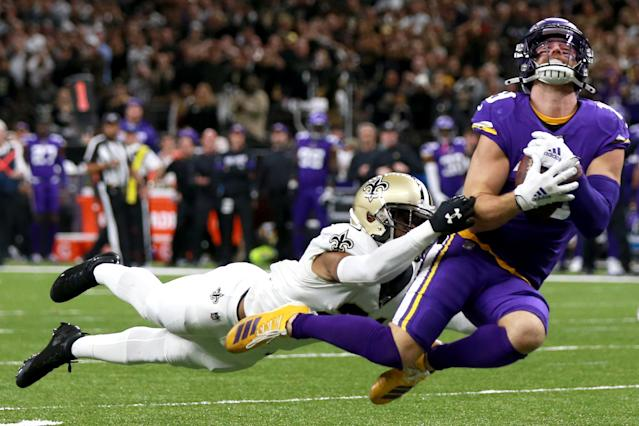 Adam Thielen of the Minnesota Vikings catches a pass over Patrick Robinson of the New Orleans Saints. (Photo by Sean Gardner/Getty Images)