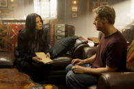 """This image released by SYFY shows Meredith Garretson, left, and Alan Tudyk in the new series """"Resident Alien."""" (James Dittinger/SYFY via AP)"""