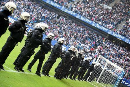 Soccer Football - Bundesliga - Hamburger SV v Borussia Moenchengladbach - Volksparkstadion, Hamburg, Germany - May 12, 2018 Riot police lined up across the pitch at the end of the match REUTERS/Fabian Bimmer