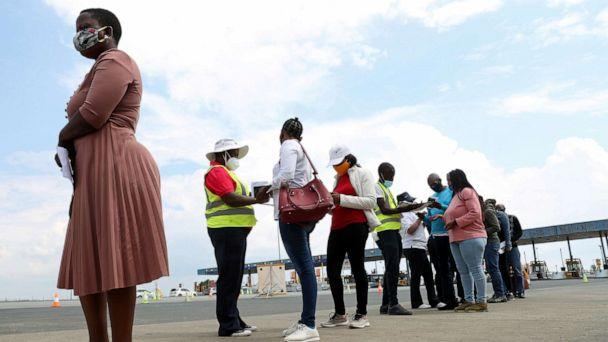 PHOTO:Travelers wait in a queue ahead of testing for the coronavirus disease amid a COVID-19 lockdown, at the Grasmere Toll Plaza, in Lenasia, South Africa on Jan. 14, 2021. (Siphiwe Sibeko/Reuters)