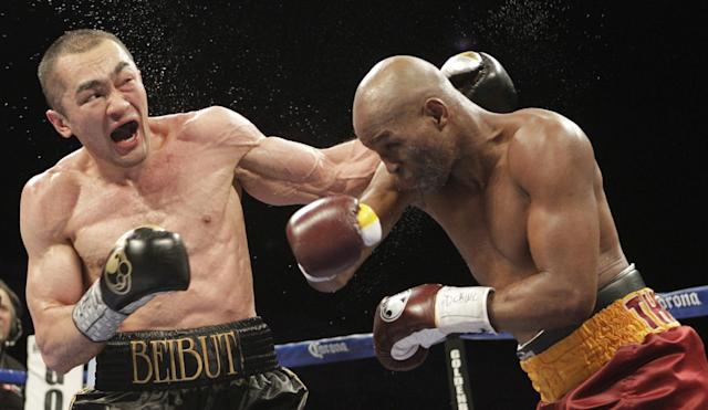 Beibut Shumenov, left, of Kazakhstan, and Bernard Hopkins, right, of the United States, fight during the eighth round of their IBF, WBA and IBA Light Heavyweight World Championship unification boxing match, Saturday, April 19, 2014, in Washington. Hopkins won by a split decision. (AP Photo/Luis M. Alvarez)