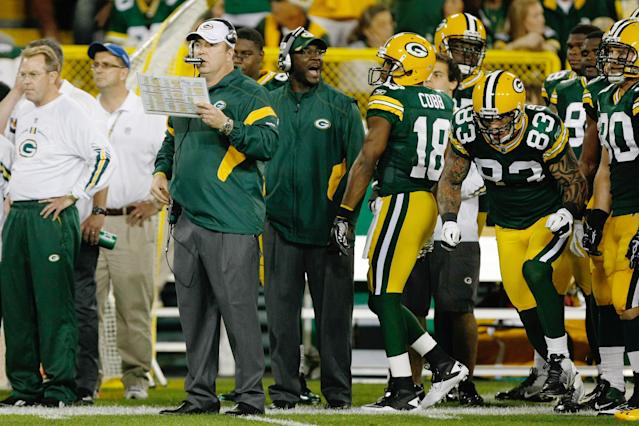 GREEN BAY, WI - SEPTEMBER 8: Mike McCarthy of the Green Bay Packers looks on as he stands on the sidelines during the game against the New Orleans Saints at Lambeau Field on September 8, 2011 in Green Bay, Wisconsin. The Saints defeated the Packers 42-34. (Photo by Scott Boehm/Getty Images)