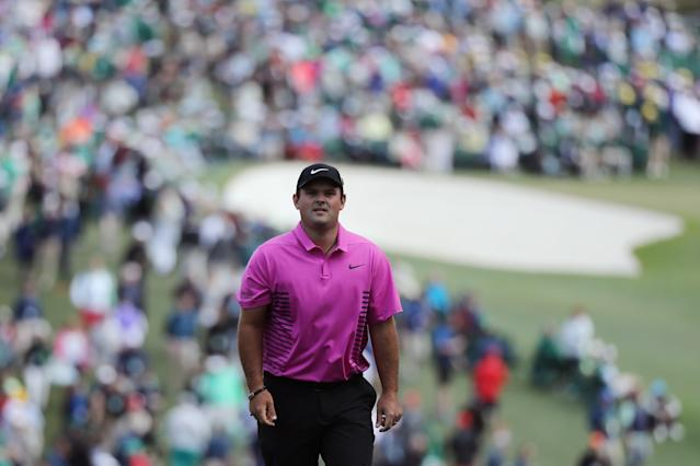 Patrick Reed of the U.S. walks up the first fairway during final round play of the 2018 Masters golf tournament at the Augusta National Golf Club in Augusta, Georgia, U.S. April 8, 2018. REUTERS/Lucy Nicholson