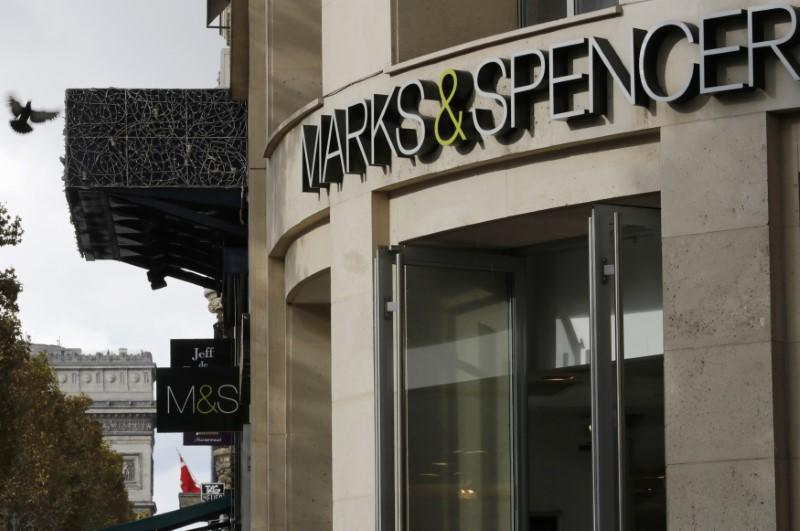 The logo of Marks & Spencer is seen in front of the store on the Champs Elysees avenue in Paris