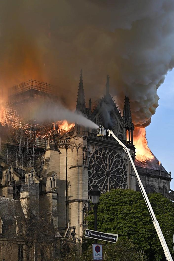 Emergency services tackle a fire at Notre-Dame de Paris, a Catholic cathedral founded in the 11th century. (Photo: Stoyan Vassev/TASS  via Getty Images)