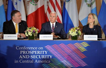Vice President Mike Pence (C) makes opening remarks as U.S. Secretary of State Mike Pompeo (L) and Dept. of Homeland Security Secretary Kirstjen Nielsen listens during the Second Conference on Prosperity and Security in Central America, which includes Mexico, Guatemala, Honduras and El Salvador, at the State Department, in Washington, U.S., October 11, 2018.          REUTERS/Mike Theiler