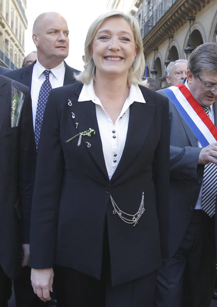Far-right National-Front party leader and candidate for the presidential elections, Marine Le Pen, leading the party's traditional May Day march to honor the birth of Joan of Arc in Paris, Tuesday, May 1, 2012. Le Pen came in a strong third place in the first round of voting, and says she will announce Tuesday how she wants her voters to cast their ballots for the runoff. Sarkozy has borrowed some of Le Pen's rhetoric and is hoping Le Pen's supporters back him. (AP Photo/Jacques Brinon)