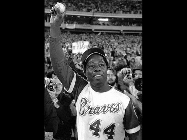 PHOTO: Hank Aaron holds the ball he hit for his 715th home run on April 8, 1974 (Associated Press)