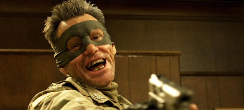 """This film publicity image released by Universal Pictures shows actor Jim Carrey portraying Colonel Stars and Stripes in a scene from """"Kick-Ass 2."""" Carrey says that he """"cannot support"""" the violence in his upcoming superhero action flick """"Kick-Ass 2"""" in the wake of the Sandy Hook Elementary School massacre. The actor tweeted Sunday, June 23, that, after shooting the film last year before the Connecticut tragedy, """"now in good conscience I cannot support that level of violence."""" Carrey added that he wasn't ashamed of the film """"but recent events have caused a change in my heart."""" """"Kick-Ass 2"""" is a sequel to the 2010 action comedy whose breakout star was the 11-year-old vigilante Hit-Girl, played by Chloe Grace Moretz. She reprises the role in the sequel, which Universal Pictures will release August 16. (AP Photo/Universal Pictures)"""