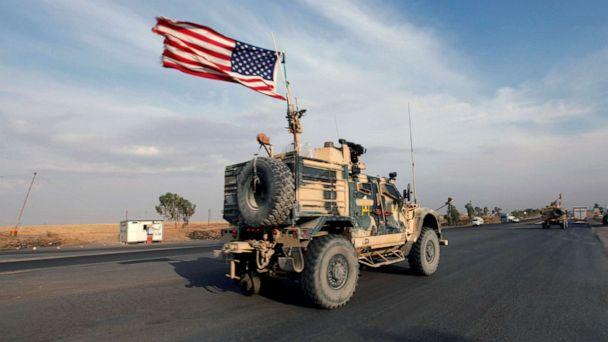 PHOTO: A convoy of U.S. vehicles are seen withdrawing from northern Syria, in Erbil, Iraq, Oct. 21, 2019. (Azad Lashkari/Reuters)
