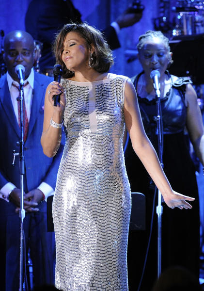 "FILE - In this Feb. 13, 2011 file photo, singer Whitney Houston performs at the pre-Grammy gala & salute to industry icons with Clive Davis honoring David Geffen in Beverly Hills, Calif. Celine Dion, Jennifer Hudson and Usher will pay tribute to the late Whitney Houston in a one-hour TV special. ""We Will Always Love You: A Grammy Salute to Whitney Houston"" will tape Oct. 11 at the Nokia Theatre L.A. Live and will feature performances by Dion, Hudson and Usher. It will air Nov. 16 on CBS. (AP Photo/Mark J. Terrill, file)"