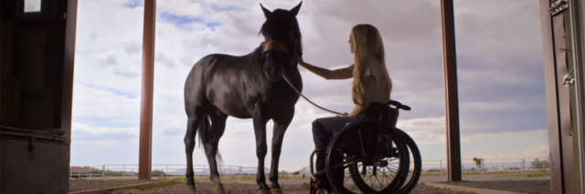 Woman in a wheelchair with horse, still from the Netflix film Walk. Ride. Rodeo. about rodeo barrel racer Amberley Snyder.
