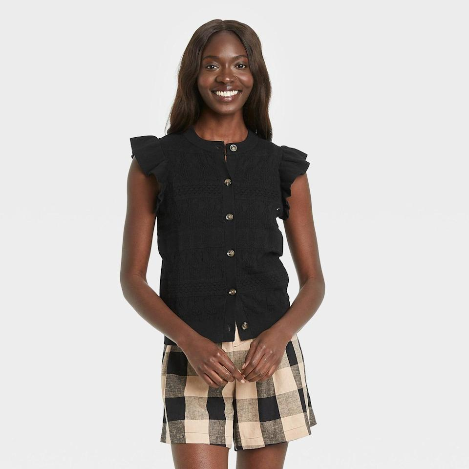 <p>When it's not too cold outside, pair a cap-sleeved <span>Who What Wear Women's Crewneck Sweater Vest</span> ($30) with the skirt of your choosing (and swap in flared pants when it is).</p>