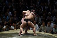 Chirac was so enamoured of the traditional Japanese sport he even named his dog Sumo (AFP Photo/Brendan SMIALOWSKI)