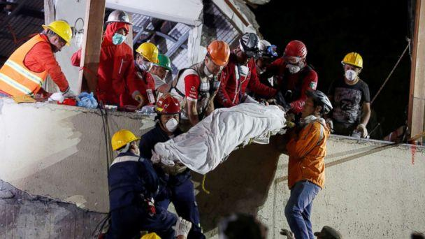 PHOTO: Rescue workers remove a dead body after searching through rubble in a a search for students at Enrique Rebsamen school in Mexico City, Mexico, Sept. 20, 2017. (Carlos Jasso/Reuters)