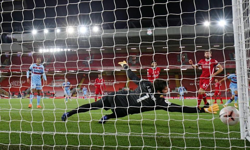 Alisson lunges to his right in vain as Pablo Fornals opens the scoring.