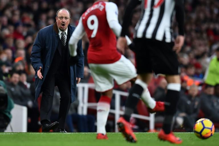 Newcastle manager Rafael Benitez (L) is aware he faces a tough task to keep the club from dropping back into the Championship