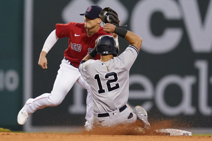 New York Yankees' Rougned Odor (12) slides, but is about to be tagged out while trying to steal second, as Boston Red Sox second baseman Enrique Hernandez catches the throw during the third inning of a baseball game at Fenway Park, Friday, July 23, 2021, in Boston. (AP Photo/Elise Amendola)